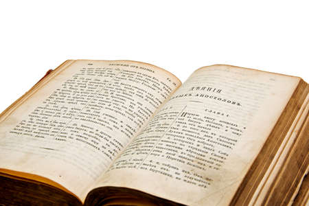 Antique open book on white background. Old Testament. photo