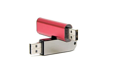 plugins: Flash drives in different colors closeup on white background Stock Photo