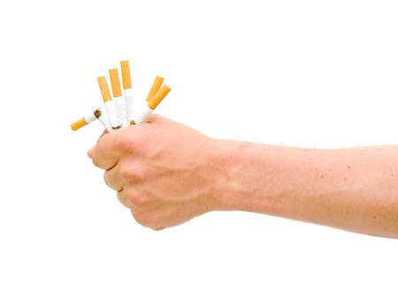 No smoking. Broken cigarette in the mens hand close-ups.