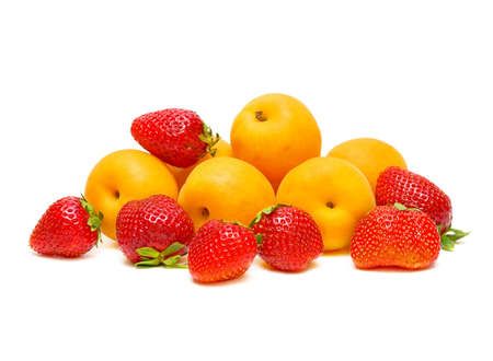 ripe strawberries and apricots on a white background