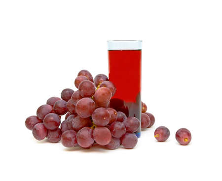 bunch of grapes and a glass of grape juice isolated on a white background