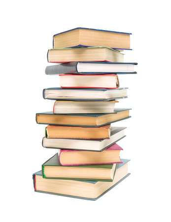stack of different books closeup isolated on white background