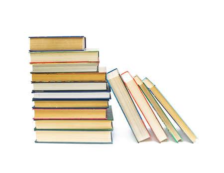 Many books closeup isolated on white background