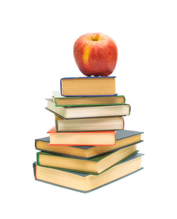 big red apple on pile of books closeup on white background