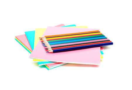notebooks and pencils colored isolated on a white background