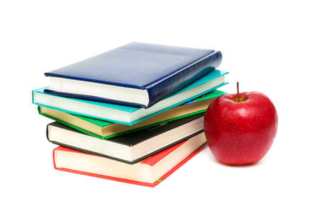 stack of books and red apple closeup isolated on white background photo