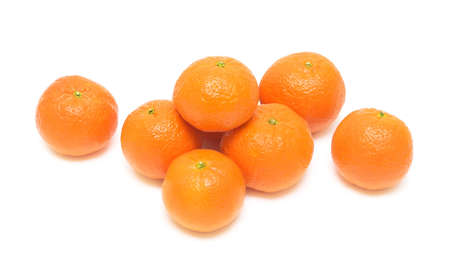 Ripe mandarins closeup, isolated on a white background