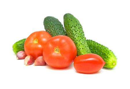Fresh tomatoes, cucumbers, garlic on a white background Stock Photo - 10572790