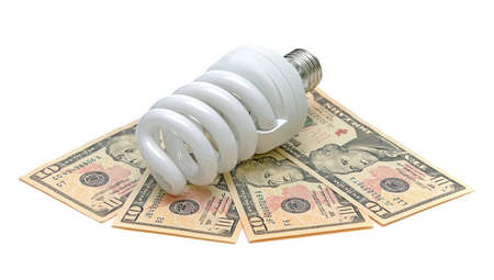 Energy saving light bulb and U.S. dollars on a white background Stock Photo