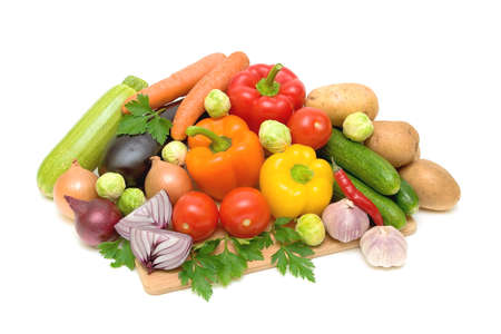 still life of fresh vegetables on a white background closeup photo