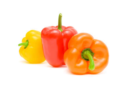 three different colored peppers isolated on white close-up photo