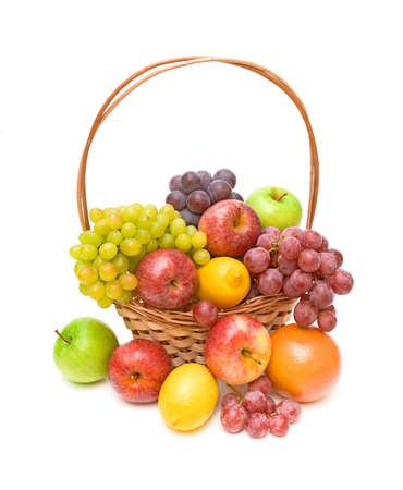 basket full of fresh fruit on a white background closeup Stock Photo
