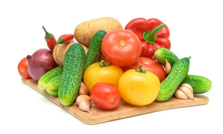 set fresh vegetables on a cutting board on white background close-up photo