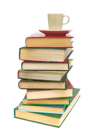 a large stack of books and coffee cup isolated on white background close-up Stock Photo