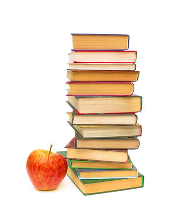 ripe red apple and a big stack of books on white background close-up Stock Photo - 11540263