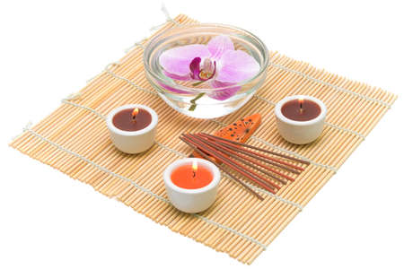 Spa concept (candles, incense sticks and orchid) on a white background photo