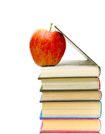 red apple and books closeup on white background