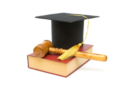 bachelor s degree: Cap graduate, gavel and book on a white background closeup