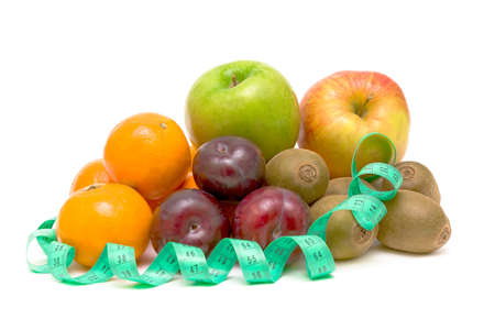 fresh fruits and a measuring tape on white background close-up Stock Photo