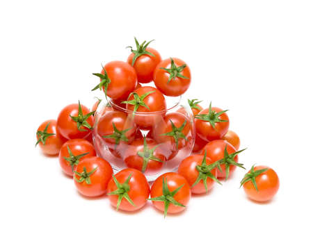 cherry tomatoes in a glass bowl isolated on white background photo