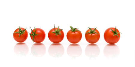 six of ripe cherry tomatoes with reflection on white background
