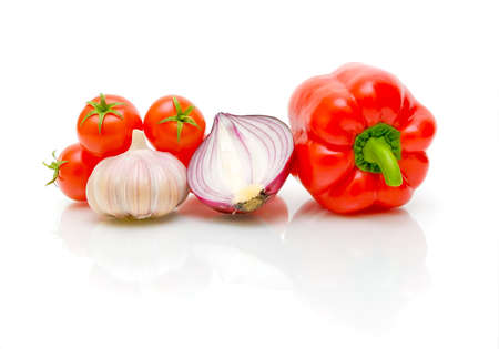 ripe cherry tomatoes, garlic, onions and peppers on a white background close-up photo