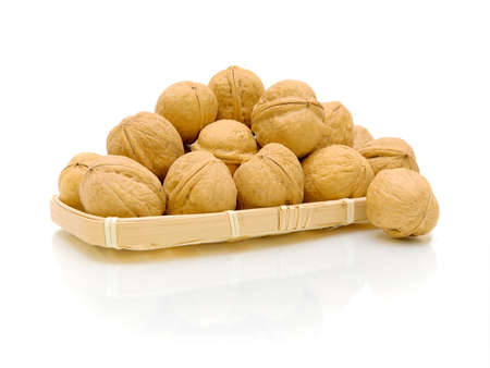 walnuts on white background with a reflection of a close-up Stock Photo - 12477779