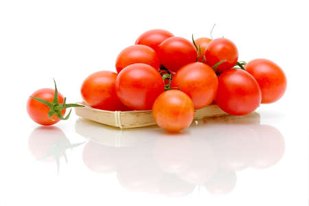 ripe and juicy tomatoes on a white background with a reflection of a close-up photo