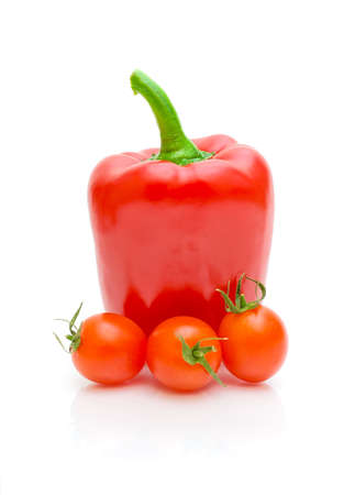 red pepper and cherry tomatoes on a white background with reflection closeup photo