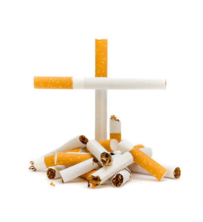 No smoking. Lots of broken cigarette isolated on a white background. photo