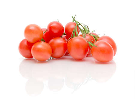 ripe cherry tomatoes on a white background with reflection photo