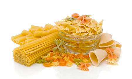 pasta of different shapes and colors on a white background