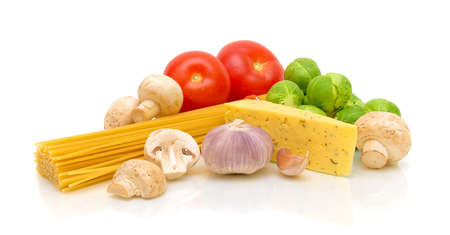 fresh vegetables, pasta, mushrooms and cheese Ammerlander on white background with reflection