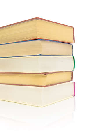 stack of books on a white background with reflection