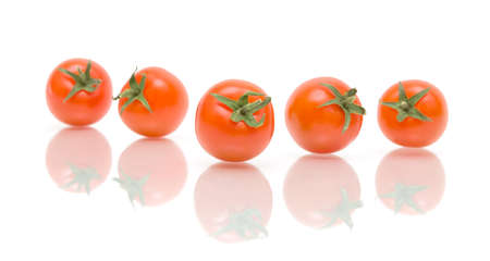 ripe cherry tomatoes on a white background with reflection closeup photo