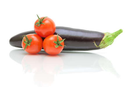 eggplant and three cherry tomato on a white background with reflection closeup photo