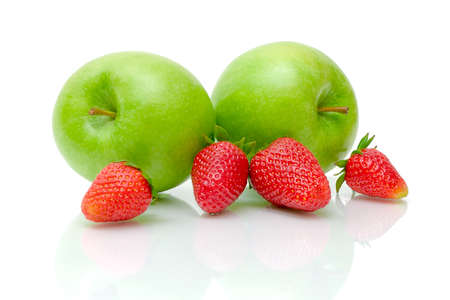 Two green apples and ripe juicy strawberries on a white background with reflection photo