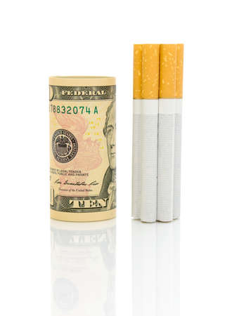 money and cigarettes isolated on a white background with reflection closeup photo