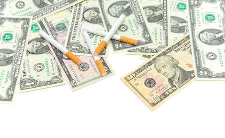 American money and cigarettes. The concept - expensive habit. photo