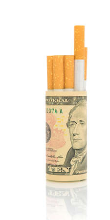No smoking. The concept - expensive habit. Cigarettes and money on a white background. photo