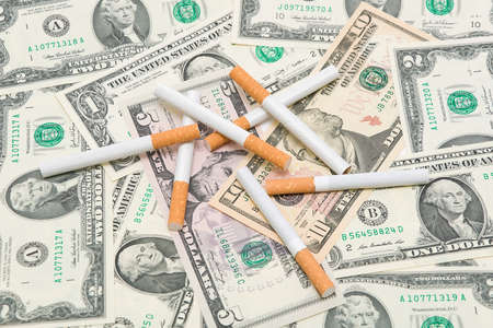 Expensive habits. Cigarettes are in U.S. dollars photo