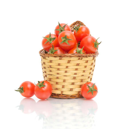 a basket of ripe tomatoes isolated on white close-up of the reflection photo
