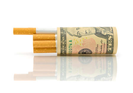 Expensive habits. Cigarettes and money on a white background. photo