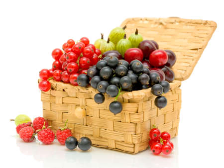 ripe, juicy berries in a wicker basket on a white background close-up photo
