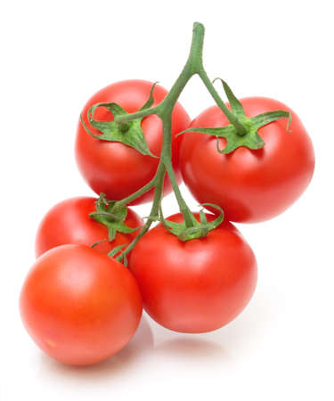 vegetable plants: bunch of fresh juicy tomatoes isolated on a white background close-up Stock Photo