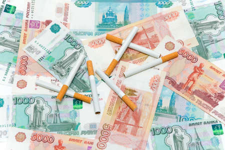 Cigarettes and Russian rubles. Expensive habits. photo