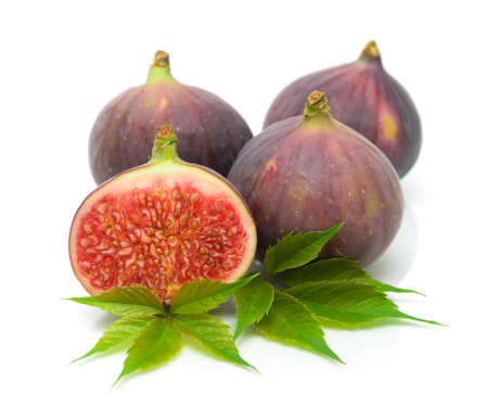 fresh, ripe, juicy figs close up isolated on white background photo