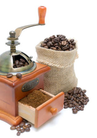 coffee beans and coffee grinder isolated on white background close-up photo