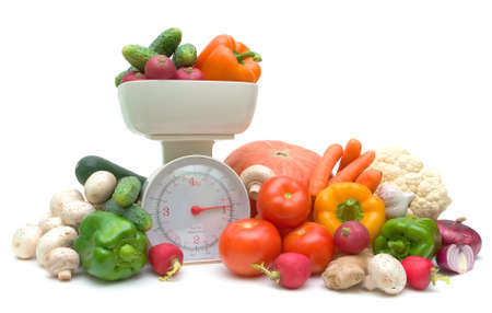 Fresh ripe vegetables and kitchen scales isolated on white background