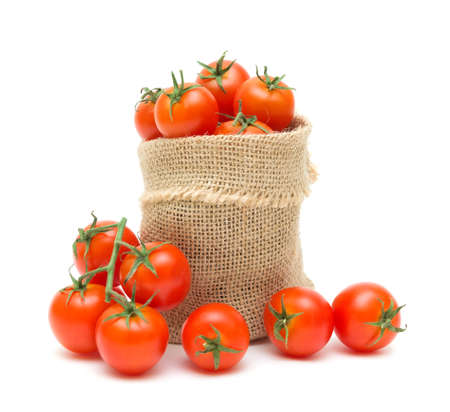 ripe cherry tomatoes in a canvas sack isolated on white background photo